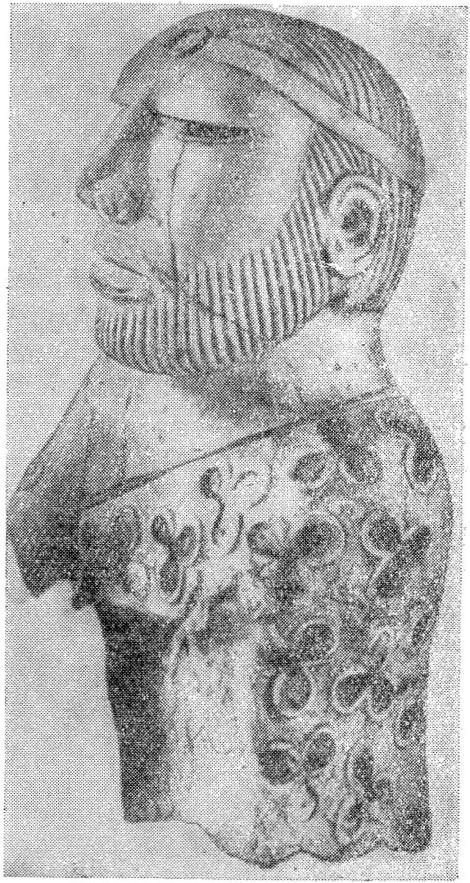 Рис. 1. Статуэтка мужского божества с характерным убором волос