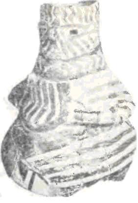 Расписной сосуд в виде сидящей богини с обсидиановыми глазами.
