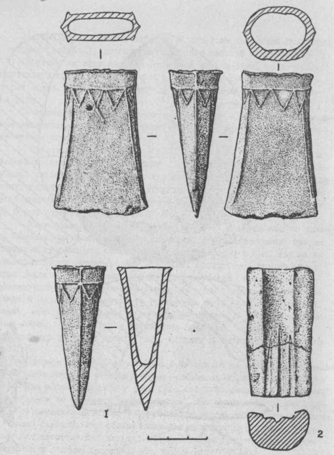 Рис. 2. Бронзовый кельт (1) и литейная форма (2).