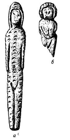 Рис. 10. Буреть. Статуэтки женщин. а — находка 1936 г.; б — находка 1939 г.