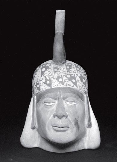 Рис. 11.11. Бутыль с носиком, народ моче, Перу. Южная Америка, Северное побережье. Сосуд — портрет правителя. Керамика с пигментированным ангобом, 300–700 год до н. э., размер 35,6 на 24,1 см