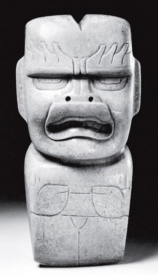 Рис. 17.7. Ольмекская фигурка со злобно сжатыми губами