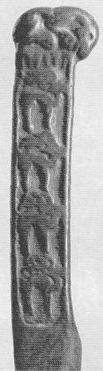 138. Фигурка тигра на рукоятке ножа с рельефным изображением оленей. Минусинская степь.