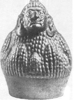 Рис. 63. Мочика. Сосуд в виде божества кукурузы. Керамика.