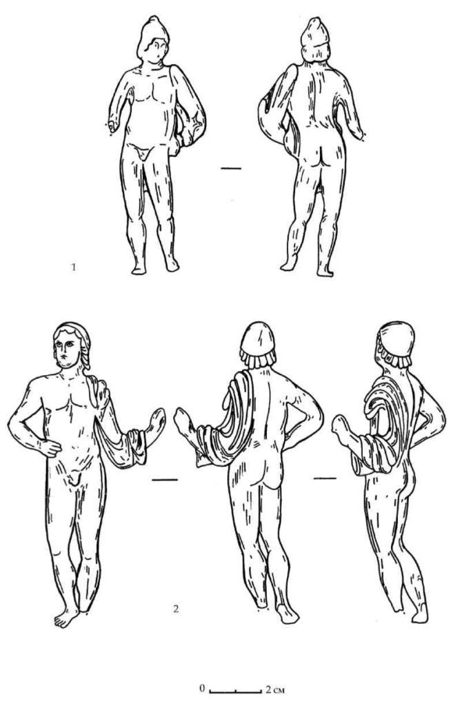 Рис. 108. Бронзовые статуэтки Диоскуров из зольника Е горизонта В
