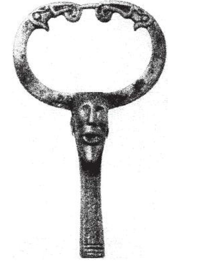 Рис. 38. Бронзовое навершие с изображением языческого бога Одина из клада инструментов VIII в. н. э., Старая Ладога.
