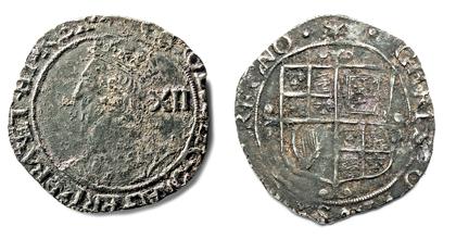 Фото пары серебряных монет 17-го века.