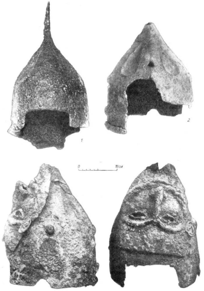Т аблица XIV. Шлемы XII—XIII вв. 1 - Копали (№ 22); 2 - Липовец (№ 21); 2а - там же (фот. из архива Н. Е. Бранденбурга).