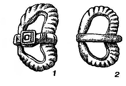 Рис. 110. В-образные пряжки из длинных курганов. 1 — Ливдора; 2 — Полибино
